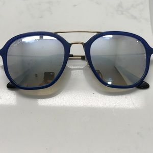 Mirrored Ray Bans with blue frame